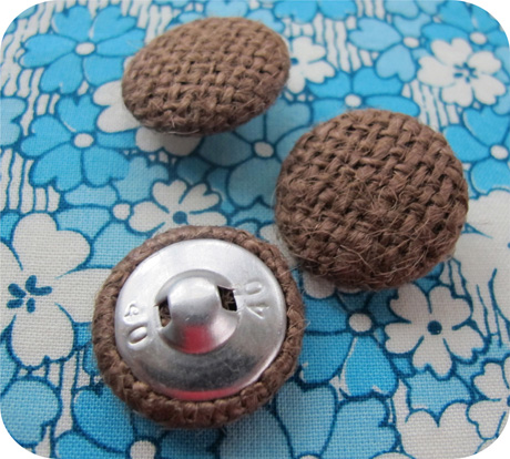 Burlap button blue background blog image