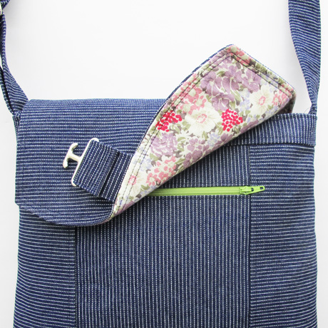 Add a zip pocket to the messenger bag